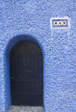 Door in blue wall Royalty Free Stock Images