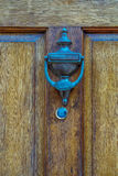 Door with brass knocker in the shape of a hand, beautiful entran Royalty Free Stock Image