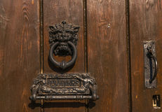 Door with brass knocker in the shape of a lion`s head, beautiful Royalty Free Stock Images