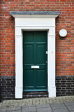 A door in a brick wall Stock Photography