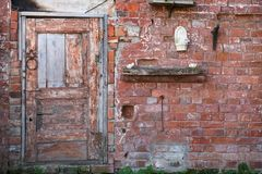 The door on the brick wall. Part of a brick wall with a door Royalty Free Stock Photography