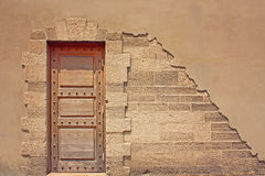 Door, bricks, and stucco Stock Photography