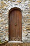 Door on bricks wall. Arch wooden door on bricks wall Royalty Free Stock Photos