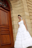 Door Bride. A bride standing by a door Stock Photos