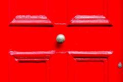 Door with bronze ornaments Stock Photo