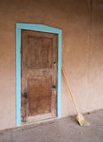 Door, with broom Royalty Free Stock Images