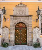 The door of the Brotherhood of blackheads in Tallinn. Estonia. On the door is the coat of Arms of the Guild of royalty free stock image