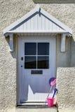 Door with bucket and spade Stock Images