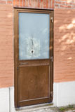 Door with a bullet hole Royalty Free Stock Photography
