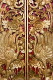 Door Carving at Pura Masceti, Bali, Indonesia. Image of intricate wood carving on a temple door at Pura Masceti, Bali, Indonesia Royalty Free Stock Image