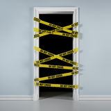 Door with caution tape Royalty Free Stock Image
