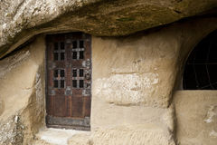 Door in a cave chapel. In an ancient monastery royalty free stock photography