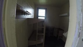 Opening door and entering prison cell with sound. Door of cell opening and entering in old prison with sound stock video