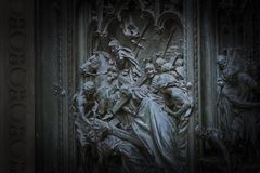 The door of the central entrance of the Duomo Cathedral of Milan with elements of the life of Jesus. Stock Photos