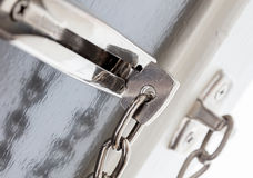 Door chain on a grey door. Security measures royalty free stock images