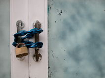 Door with chain and padlock Royalty Free Stock Images