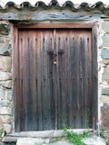 Door in chains. An old door at the village of Fikardou, Cyprus Stock Images