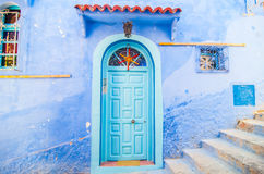A door in chefchaouen the blue city in morocco. Such a unique architecture inspired by the spanish culture in the city of chefchaouen in the north of morocco Stock Images