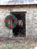 Door with Christmas Wreath. Rock barn doorway with Christmas wreath Stock Image
