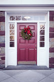 Door with Christmas Wreath Royalty Free Stock Photo