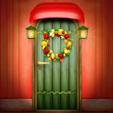 Door with Christmas wreath Royalty Free Stock Images