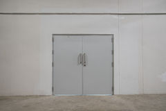 Door with chrome silver handles set royalty free stock photo