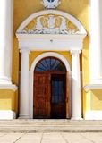 Door of church. And yellow wall Stock Photography