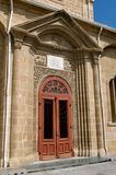 Door in a church. Door in a church between columns and above a arch in Nicosia in Cyprus Royalty Free Stock Photos