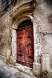 A door in the city of Mdina, Malta. A photo of an old red door in the historical city of Mdina, Malta Stock Photos