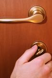 Door close. Hand is closing door by key. All focused (Hand and door Stock Images