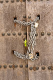 Door closed with chains, Osuna, Sevilla province Stock Photos