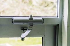 Door Closer on Glass door on building entrace royalty free stock photo