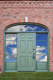 Door with clouds Royalty Free Stock Image