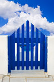 Door and cloudy sky Royalty Free Stock Image