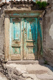 Door on cobbled Turkish street. Old weathered door and crumbling wall in Ankara, Turkey Royalty Free Stock Photo