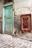 Door on cobbled Turkish street. Old weathered door with rug hanging on crumbling wall in Ankara, Turkey Royalty Free Stock Photo