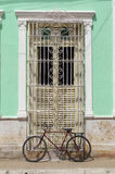 Door of a colonial house in Trinidad, Cuba. A red bicycle parked in front of the entrance of a colonial house in Trinidad, Cuba stock photos