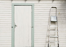 Door on cottage. Clean door on white cottage Royalty Free Stock Photo