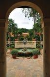 Door into courtyard fountain Stock Photos
