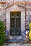 Door of crypt. The door of the stone crypt closeup front view Stock Image