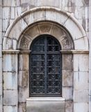 Door of crypt. The wrought door of the stone crypt on the Montjuic Cemetery closeup front view, Barcelona, Catalonia, Spain royalty free stock image