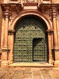 Door of Cusco Church. The massive green door of the Cathedral Basilica of the Assumption of the Virgin in Cusco, Peru, welcomes visitors. Located on the Plaza de Stock Images