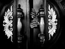 The door of the dark hand royalty free stock image