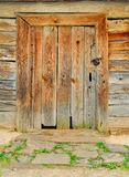 Door from a dark tree. Old door from a dark tree on a ansient back Royalty Free Stock Images