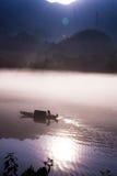 Door de zonneschijn in het water Stock Foto