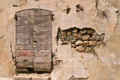 Door in decay. An old door in a wall. L'lle Rousse, Corsica, France royalty free stock photography