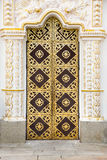 Door decorated with gold. The door to the Cathedral of the Assumption of the Kiev-Pechersk Lavra. The famous monastery included in UNESCO world heritage Royalty Free Stock Photography