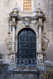 Door decorated in Italian Barocco style. Beauty of architecture Stock Photos
