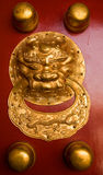 Door decoration in gold. In the Forbidden City, China Stock Images