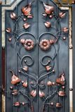 Door decoration with ornate wrought-iron elements, close up.  stock photo
